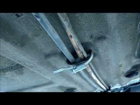 Крепление топривных трубок к днищу автомобиля Ford Sierra