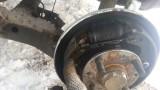 Замена задних тормозных колодок Mazda Demio