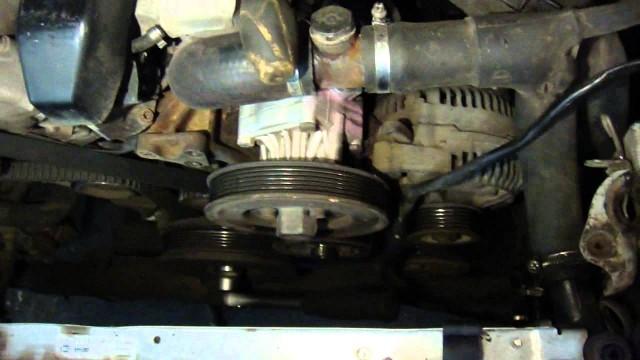 Замена помпы Audi 100 S4